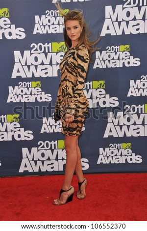 LOS ANGELES, CA - JUNE 5, 2011: Rosie Huntington-Whiteley  arrives at the 2011 MTV Movie Awards at the Gibson Amphitheatre, Universal Studios, Hollywood. June 5, 2011  Los Angeles, CA - stock photo