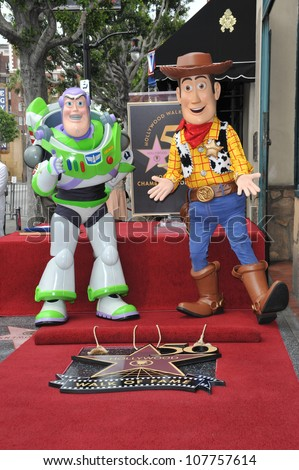 LOS ANGELES, CA - JUNE 2, 2010: Toy Story stars Buzz Lightyear (left) & Woody on Hollywood Boulevard where composer Randy Newman was honored today with a star on the Hollywood Walk of Fame.