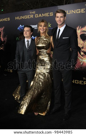 LOS ANGELES, CA - MAR 12: Josh Hutcherson, Jennifer Lawrence, Liam Hemsworth at the premiere of Lionsgate's 'The Hunger Games' at Nokia Theater L.A. Live on March 12, 2012 in Los Angeles, California - stock photo