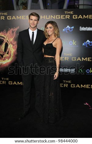 LOS ANGELES, CA - MAR 12: Miley Cyrus, Liam Hemsworth at the premiere of Lionsgate's 'The Hunger Games' at Nokia Theater L.A. Live on March 12, 2012 in Los Angeles, California