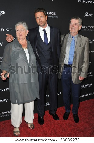 """LOS ANGELES, CA - MARCH 18, 2013: Gerard Butler & parents at the Los Angeles premiere of his movie """"Olympus Has Fallen"""" at the Cinerama Dome, Hollywood."""