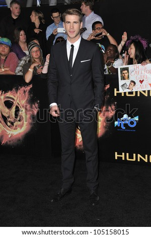 "LOS ANGELES, CA - MARCH 12, 2012: Liam Hemsworth at the world premiere of his new movie ""The Hunger Games"" at the Nokia Theatre L.A. Live. March 12, 2012  Los Angeles, CA"