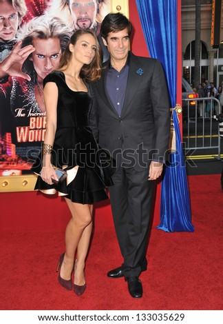 """LOS ANGELES, CA - MARCH 11, 2013: Magician David Copperfield & girlfriend Chloe Gosselin at the world premiere of """"The Incredible Burt Wonderstone"""" at the Chinese Theatre, Hollywood."""