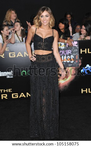 """LOS ANGELES, CA - MARCH 12, 2012: Miley Cyrus at the world premiere of """"The Hunger Games"""" at the Nokia Theatre L.A. Live. March 12, 2012  Los Angeles, CA - stock photo"""