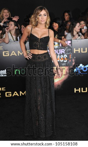 "LOS ANGELES, CA - MARCH 12, 2012: Miley Cyrus at the world premiere of ""The Hunger Games"" at the Nokia Theatre L.A. Live. March 12, 2012  Los Angeles, CA"