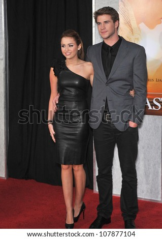 """LOS ANGELES, CA - MARCH 25, 2010: Miley Cyrus & Liam Hemsworth at the world premiere of their new movie """"The Last Song"""" at the Arclight Theatre, Hollywood."""