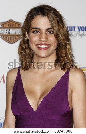 LOS ANGELES, CA - MAY 19: Natalie Morales arrives at the 11th annual Maxim Hot 100 Party at Paramount Studios on May 19, 2010 in Los Angeles, California