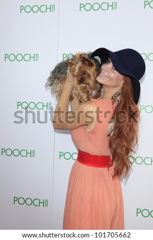 LOS ANGELES, CA - MAY 3: Phoebe Price, dog Henry at the grand opening of the Pooch Hotel on May 3, 2012 in Hollywood, Los Angeles, California. The Pooch Hotel is a luxury hotel for dogs.
