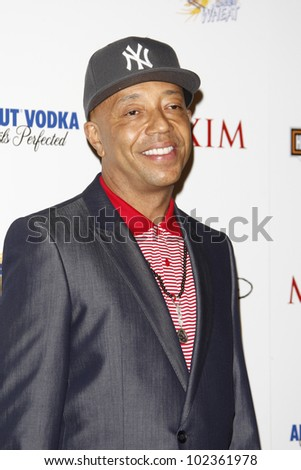 LOS ANGELES, CA - MAY 19: Russell Simmons arrives at the 11th annual Maxim Hot 100 Party at Paramount Studios on May 19, 2010 in Los Angeles, California - stock photo