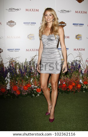LOS ANGELES, CA - MAY 19: Stacy Keibler arrives at the 11th annual Maxim Hot 100 Party at Paramount Studios on May 19, 2010 in Los Angeles, California - stock photo