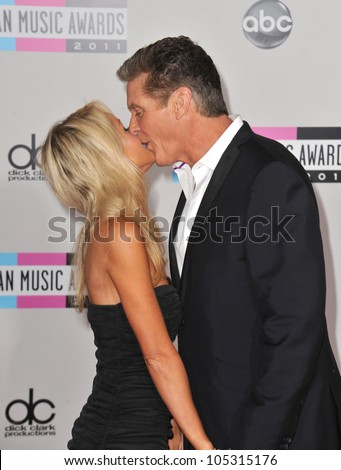 LOS ANGELES, CA - NOVEMBER 20, 2011: David Hasselhoff & girlfriend at the 2011 American Music Awards at the Nokia Theatre, L.A. Live in downtown Los Angeles. November 20, 2011  Los Angeles, CA