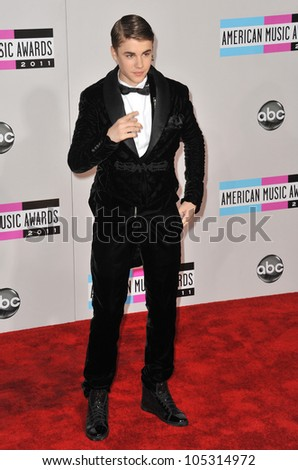 LOS ANGELES, CA - NOVEMBER 20, 2011: Justin Bieber arriving at the 2011 American Music Awards at the Nokia Theatre, L.A. Live in downtown Los Angeles. November 20, 2011  Los Angeles, CA