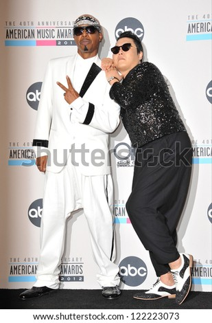 LOS ANGELES, CA - NOVEMBER 18, 2012: MC Hammer & Psy (right) at the 40th Anniversary American Music Awards at the Nokia Theatre L.A. Live.