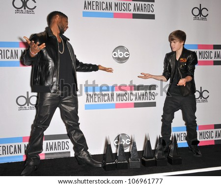 LOS ANGELES, CA - NOVEMBER 21, 2010: Usher & Justin Bieber (right) at the 2010 American Music Awards at the Nokia Theatre L.A. Live.