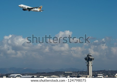 LOS ANGELES, CA - OCTOBER 23: A Frontier Airlines passenger jet takes off from Los Angeles International Airport (LAX) in Los Angeles, CA on October 23, 2012.