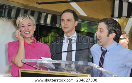 LOS ANGELES, CA - OCTOBER 29, 2014: Kaley Cuoco & co-stars from The Big Bang Theory - Jim Parsons & Simon Helberg - on Hollywood Blvd where she received a star on the Hollywood Walk of Fame.