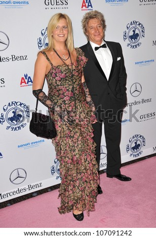 LOS ANGELES, CA - OCTOBER 23, 2010: Rod Stewart & wife Penny Lancaster at the 32nd Anniversary Carousel of Hope Ball at the Beverly Hilton Hotel. - stock photo