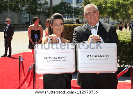 LOS ANGELES, CA - SEP 15: Ernst & Young reps with winners at the Academy Of Television Arts & Sciences 2012 Creative Arts Emmy Awards at Nokia Theater on September 15, 2012 in Los Angeles, CA - stock photo