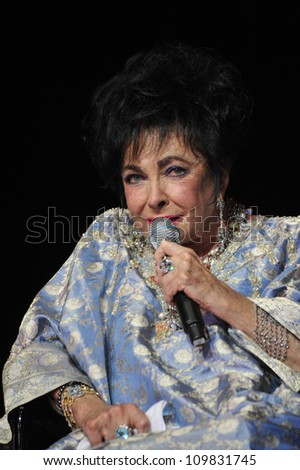 LOS ANGELES, CA - SEPTEMBER 24, 2009: Dame Elizabeth Taylor at the Macy's Passport 2009 Fashion Show at Barker Hanger, Santa Monica Airport.