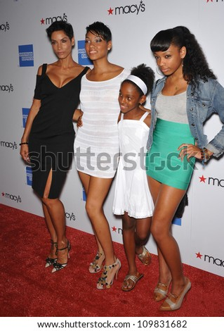 LOS ANGELES, CA - SEPTEMBER 24, 2009: Nicole Murphy (former wife of Eddie Murphy) & daughters Bria (left), Zola & Shayne at the Macy's Passport 2009 Fashion Show at Barker Hanger, Santa Monica Airport