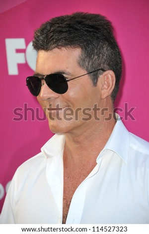 """LOS ANGELES, CA - SEPTEMBER 11, 2012: Simon Cowell at the season two premiere of """"X Factor USA"""". He had his handprints set in cement at Grauman's Chinese Theatre"""