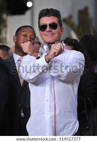 "LOS ANGELES, CA - SEPTEMBER 11, 2012: Simon Cowell at the season two premiere of ""X Factor USA"". He had his handprints set in cement at Grauman's Chinese Theatre"