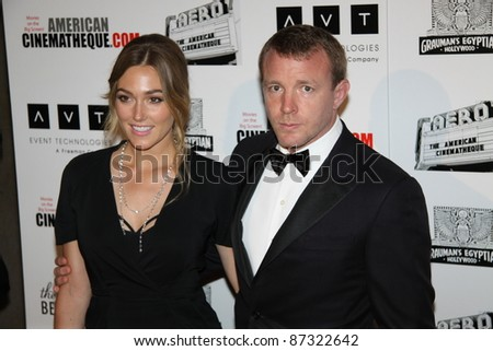 LOS ANGELES, CA, USA - OCTOBER 14: Director Guy Ritchie and date attend the 25Th American Cinematheque Awards Ceremony at the Beverly Hilton on October 14, 2011 in Los Angeles, CA.