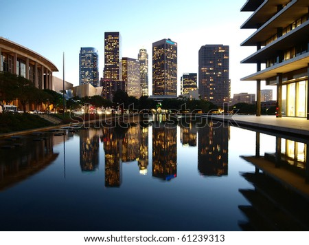 LOS ANGELES, CALIFORNIA - OCTOBER 28: LA DWP's architectually renown 1963 headquarters (architect Albert C Martin) and pond reflect modern towers on October 28, 2008 in Los Angeles, California.