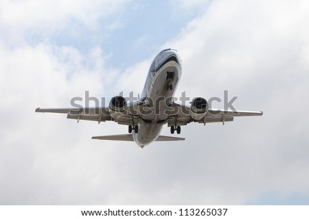 """LOS ANGELES, CALIFORNIA, USA - APRIL 27: An Alaska Airlines Boeing 737 landing at Los Angeles Airport, on April 27, 2012 in Los Angeles, CA.  The non-circular """"hamster pouch"""" engine inlets are more fuel efficient."""
