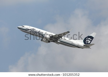 LOS ANGELES, CALIFORNIA, USA - APRIL 27, 2012. An Alaska Airlines Boeing 737-890 (N552AS) takes off from Los Angeles Airport on April 27, 2012 in Los Angeles, CA.  It seats 162 passengers with a range of 3,060 miles.