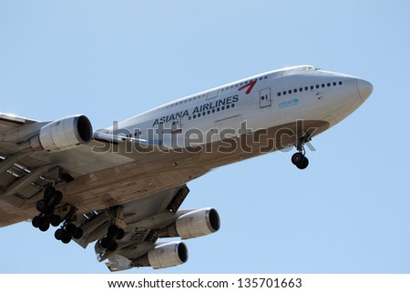 LOS ANGELES, CALIFORNIA, USA - APRIL 17 : Asiana Airlines Boeing 747-48E lands at Los Angeles Airport on April 17, 2013. The 400 series is 4% more fuel efficient than other 747's.