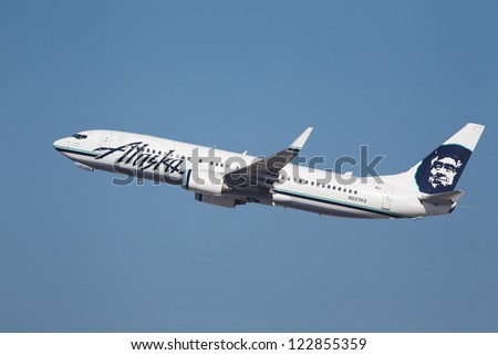 LOS ANGELES, CALIFORNIA, USA - DECEMBER 11 : Alaska Airlines Boeing 737-990 takes off from Los Angeles International Airport on December 11, 2012.  The plane has a speed of 588 mph.