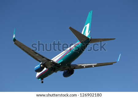 LOS ANGELES, CALIFORNIA, USA - JANUARY 28: An Airtran Boeing 737-700 lands at Los Angeles Airport on January 28, 2013. The plane seats 126 passengers with a range of 6,370 km