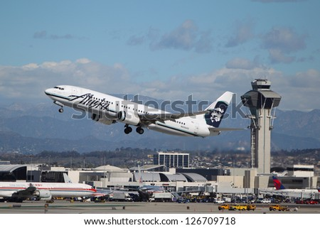 LOS ANGELES, CALIFORNIA, USA - JANUARY 28: An Alaska Airlines Boeing 737-890  takes off from Los Angeles Airport on January 28, 2013. The plane seats 126 passengers with a range of 10,200 km