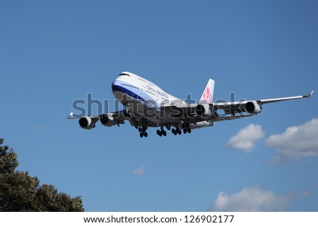 LOS ANGELES, CALIFORNIA, USA - JANUARY 15: China Airlines Boeing 747-409 lands at Los Angeles Airport on January 15, 2013. The 400 series is 4% more fuel efficient than other 747's.