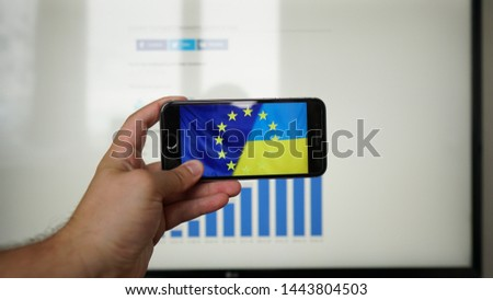 Los Angeles, California, USA - 07 July 2019. Combination of European Union and Ukraine flags on smartphone screen  #1443804503