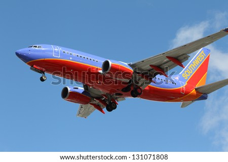 LOS ANGELES, CALIFORNIA, USA - MARCH 8, 2013.   Southwest Airlines Boeing 737-7H4 lands at Los Angeles Airport on March 8, 2013. The plane has a range of 6,340 miles with 177 seats.