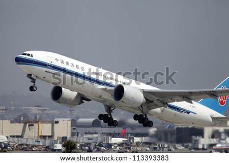 LOS ANGELES, CALIFORNIA, USA - SEPTEMBER 17: A China Southern Cargo Boeing 777F  takes off from Los Angeles Airport on September 17, 2012.  The freighter has a range of 4,900 miles fully loaded.