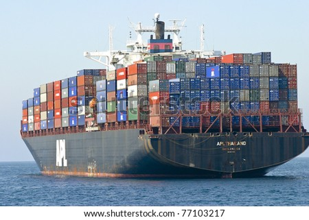 LOS ANGELES, CALIFORNIA, USA - SEPTEMBER 11: Cargo container ship comes into port on September 11, 2004 in Los Angeles, CA - stock photo