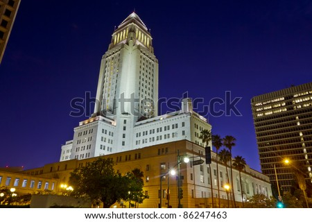 Los Angeles City Hall at nighttime shot from ground level. with other Civic Center building framing the shot.