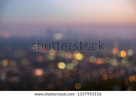Los Angeles cityscape at night with lights blurred into bokeh circles background. #1337993156