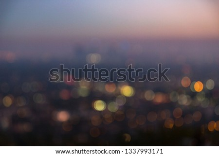 Los Angeles cityscape at night with lights blurred into bokeh circles background. #1337993171