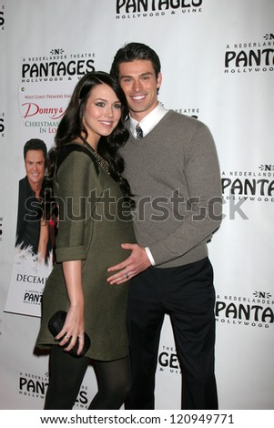 """LOS ANGELES - DEC 4:  Adam Gregory and wife arrives to """"Donny & Marie - Christmas in Los Angeles"""" Opening Night at Pantages Theater on December 4, 2012 in Los Angeles, CA"""