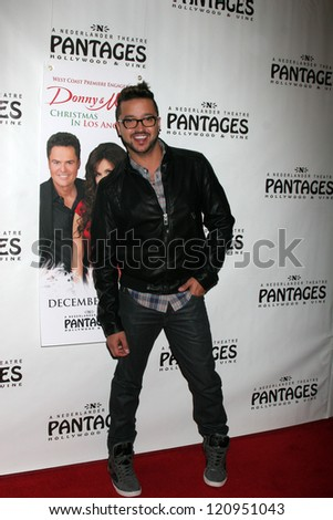 """LOS ANGELES - DEC 4:  Jai Rodriguez arrives to """"Donny & Marie - Christmas in Los Angeles"""" Opening Night at Pantages Theater on December 4, 2012 in Los Angeles, CA"""