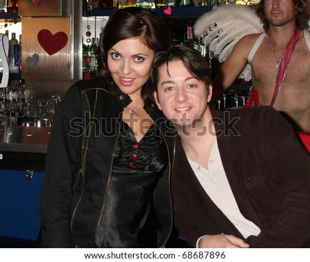 """LOS ANGELES - DEC 17:  Jo Bozarth,  Bradford Anderson on set during the making of the movie """"Cupid and Eros""""  at The Good Nite Bar on December 17, 2010 in Los Angeles, CA"""