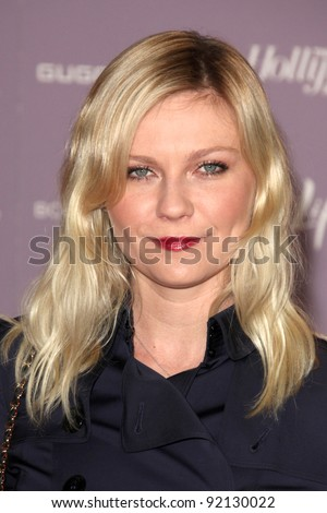"""LOS ANGELES - DEC 7:  Kirsten Dunst arrives at the """"Power 100: Women In Entertainment Breakfast"""" at Beverly Hills Hotel on December 7, 2011 in Beverly Hills, CA - stock photo"""