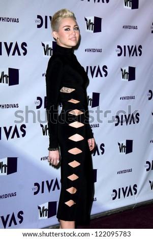 LOS ANGELES - DEC 16:  Miley Cyrus arriving at the VH1 Divas Concert 2012 at Shrine Auditorium on December 16, 2012 in Los Angeles, CA