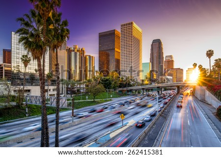Los Angeles downtown buildings and highway car traffic at sunset #262415381