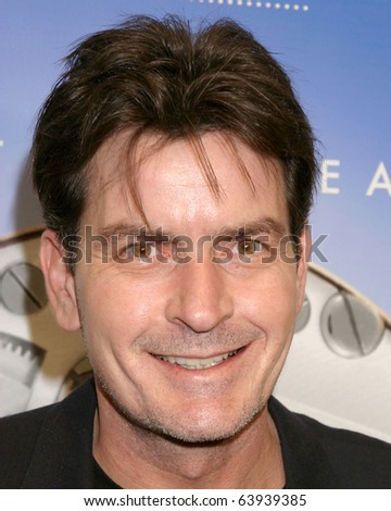 LOS ANGELES FEB 15 Charlie Sheen arrives at the Omegamania-Antiquor um Cocktail Reception at Regent Beverly Wilshire Hotel on February 15 2007 in Beverly Hills CA.
