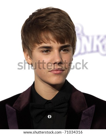 "LOS ANGELES - FEB 09:  JUSTIN BIEBER arrives to the ""Justin Bieber: Never Say Never"" Los Angeles Premiere  on February 08,2011 in Los Angeles, CA"
